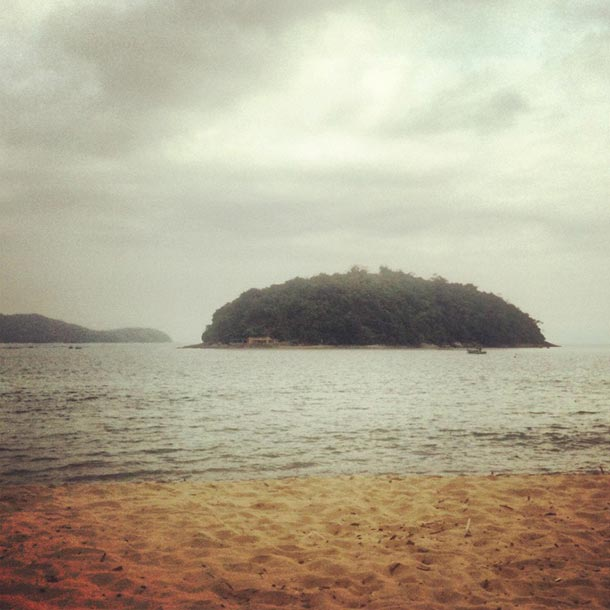 View from beach of un-named little island just off Cocanha