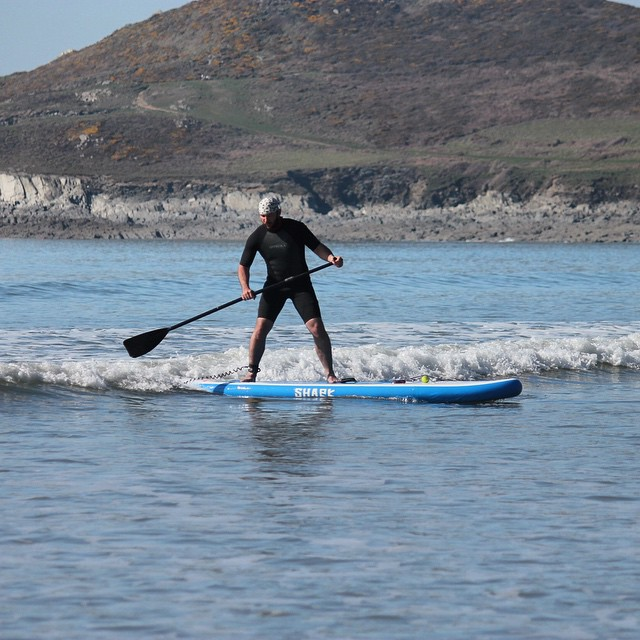 Joel testing out one of his new shark SUPs. #woolacombe #devon #sup #standuppaddle. Photo by: @essexrambler
