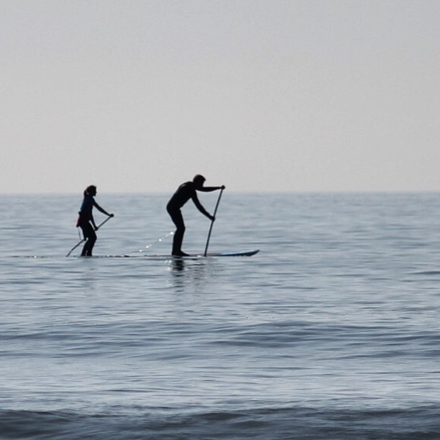 Husband and wife off exploring. #woolacombe #devon #sup #standuppaddle. Photo by: @essexrambler