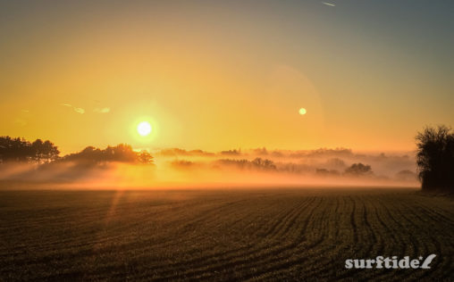 Misty winter sunset across a farmer's field in Bishops Stortford, Hertfordshire