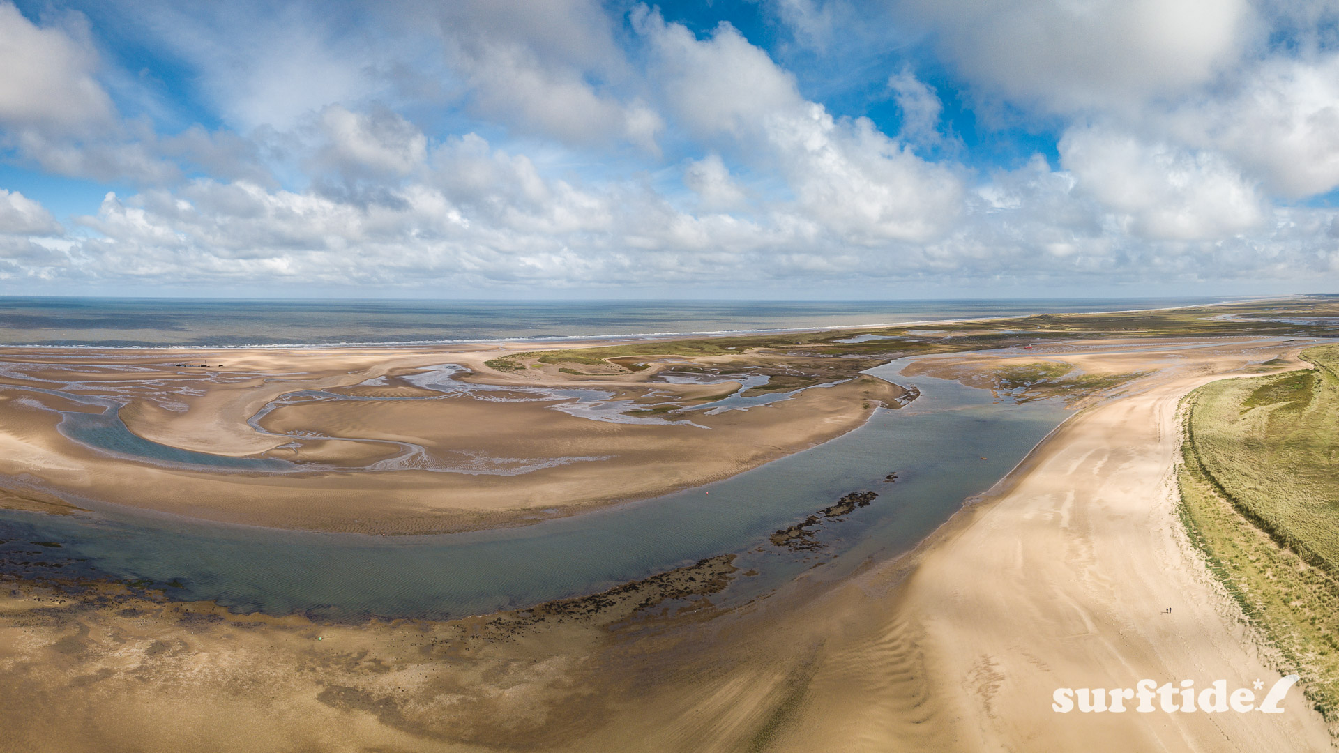 Aerial photo of Brancaster Beach at low tide.
