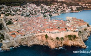 Aerial view of the city of Dubrovnik showing the historic city walls and the sea and harbour
