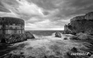Black & white photo of storm waves entering Dubrovnik West harbour in southern Croatia