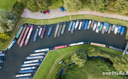 Aerial view of the long boats all lined up at Hallingbury marina in Essex