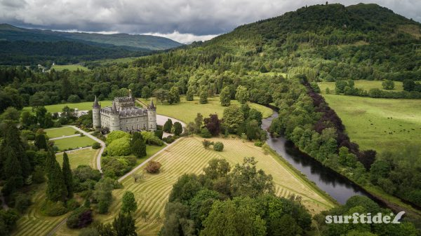 Aerial view of the river, grounds and surrounding hills on a cloudy day at Inveraray Castle in Scotland