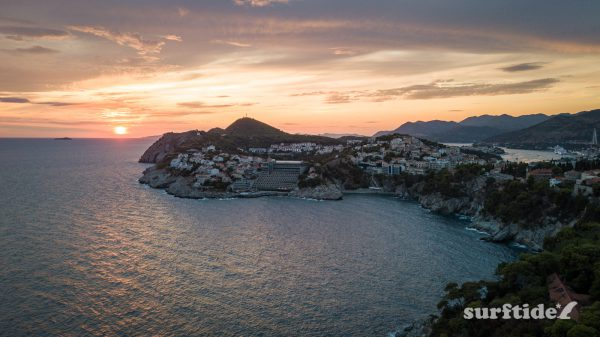Aerial photo showing the sun setting over the sea in Dubrovnik southern Croatia