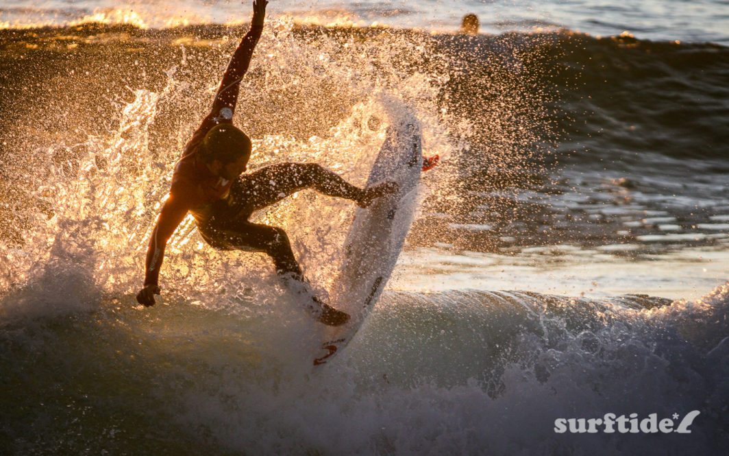 Photo of a surfer in mid-air at Supertubos, Peniche Beach
