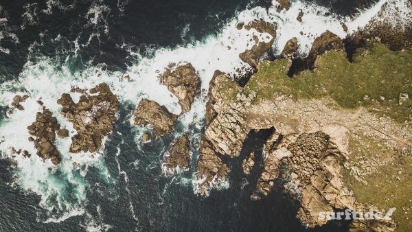 Aerial photo showing top-down view of Lands End headland, Cornwall, England