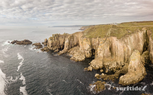 Aerial photo of the sea and rocky coastline at Land's End, Cornwall, England