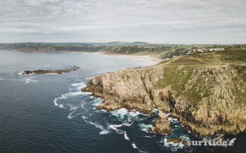 Aerial photo of the sea and rocky cliffs near Sennen Cove, Cornwall, England