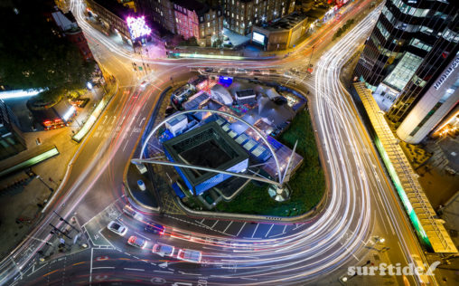 Long exposure aerial photo of the Old Street roundabout showing light trails from the passing traffic in London