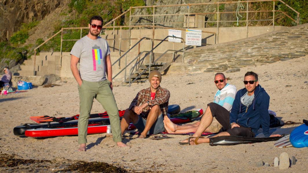 Luke, Ben E, Richie and Ben C sitting on Barricane Beach, Woolacombe, Devon in 2015