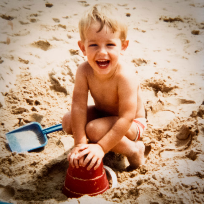 Ben on the beach making a sandcastle in 1981