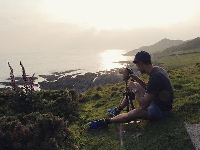 Ben taking photos of sunset by Luke Reynolds