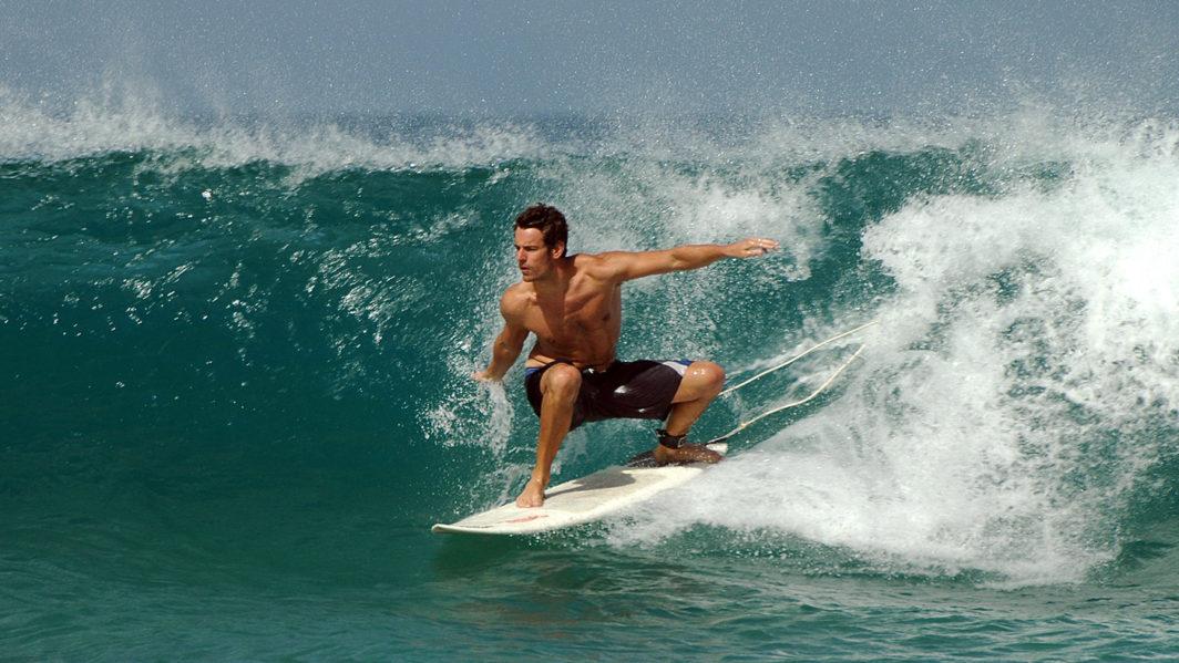 Ben Ellis surfing on a short board at El Cotillo beach, Fuerteventura in 2007