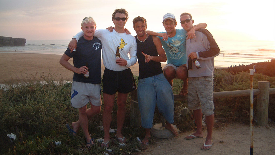James, Tim, Eurico, Richie and Ben drinking beers at sunset after a days surfing in southern Portugal in 2007