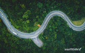 Aerial shot of winding road through tropical mountains in Brazil