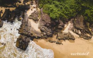 An aerial photo of the beautiful rock strata and sandy beach