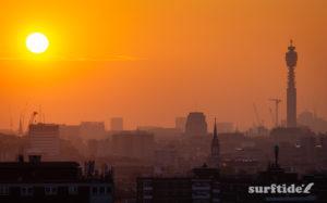 Sun setting across the skyline of London